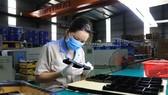 Công nhân tại một doanh nghiệp ở Bắc Ninh. (Nguồn: TTXVN)