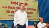 Bí Thư Thành ủy TPHCM Nguyễn Thiện Nhân phát biểu trong buổi tiếp xúc cử tri quận Tân Bình. Ảnh: VIỆT DŨNG