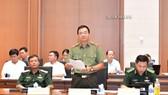 Ông Nguyễn Minh Đức, Phó Chủ nhiệm Ủy ban Quốc phòng và An ninh của Quốc hội trình bày Báo cáo thẩm tra dự án luật
