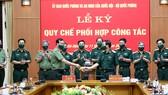 Lãnh đạo Ủy ban Quốc phòng và An ninh cùng Bộ Quốc phòng ký Quy chế phối hợp công tác    