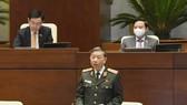 Bộ trưởng Bộ Công an Tô Lâm phát biểu tại phiên họp sáng 26-10 của Quốc hội. Ảnh: QUANG PHÚC