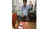 Nguyễn Văn Bình tại cơ quan công an. Ảnh: CHÍ THẠCH