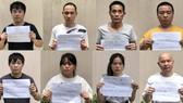 Nhóm nhóm nam nữ người Trung Quốc nghi nhập cảnh trái phép ở Công viên Gia Định. Ảnh: CHÍ THẠCH