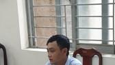 Đối tượng Thái tại cơ quan công an. Ảnh: CHÍ THẠCH