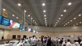 Hành khách làm thủ tục tại sân bay của Moscow