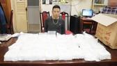 Một đối tượng trong băng nhóm buôn bán ma túy bị bắt giữ. Ảnh: PC04 Hà Nội cung cấp