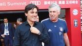 Carlo Ancelotti (phải) và Vincenzo Montella