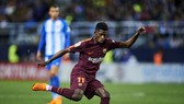 Ousmane Dembele tỏa sáng trong trận thắng Malaga. Ảnh: Getty Images.