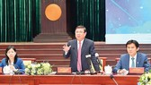 Chairman of HCMC People's Committee Nguyen Thanh Phong is delivering his speech in the meeting. (Photo: SGGP)