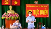 Secretary of HCMC Party Committee Nguyen Van Nen is on his visit to Vinh Loc B Commune of Binh Chanh District. (Photo: SGGP)