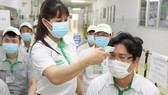 Employees of Nidec Co. in Saigon Hi-tech Park are being vaccinated. (Photo: SGGP)