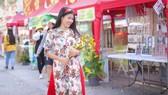 Người đẹp điền kinh Lê Thị Mộng Tuyền thướt tha trong tà áo dài truyền thống du xuân