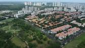 Thảm xanh trong đô thị giúp thành phố thoát nước tốt hơn. Ảnh: CAO THĂNG
