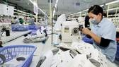 Sản xuất, xuất khẩu dệt may, da giày tăng trưởng khá