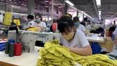 Công nhân miền Bắc trở lại làm việc trong tâm dịch