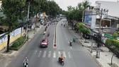 Lượng phương tiện lưu thông trên trục đường Quang Trung (quận Gò Vấp) ngày 29-9 khá đông đúc. Ảnh: BÙI ANH TUẤN
