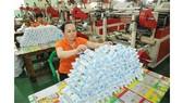 Sản xuất bao bì nhựa xuất khẩu tại Công ty Nam Thái Sơn. Ảnh: CAO THĂNG