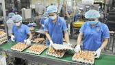 Tăng liên kết phát triển sản xuất và hạ tầng thương mại