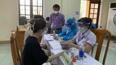 Một điểm tiêm chủng do CDC Quảng Bình triển khai tại Đồng Hới được giám sát chặt chẽ