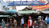 Kiểm tra đeo khẩu trang, đo thân nhiệt tại chợ và hàng quán ven đường
