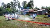 Lực lượng thú y An Giang diễn tập phòng chống dịch tả heo châu Phi. Ảnh: NHƯ HÙNG
