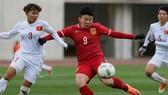 Chương Thị Kiều cùng ĐT Việt Nam trong trận gặp Trung Quốc ở vòng loại Olympic Rio 2016