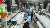Garment and textile enterprises apply modern technology in production. (Photo: SGGP)