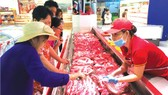 The price of pork was kept stable during Tet holidays. (Photo: SGGP)