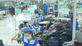 Garment production for export at Nha Be Garment Corporation. (Photo: SGGP)