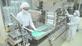 Manufacturing products for domestic consumption and export at Agimexpharm. (Photo: SGGP)