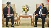 Prime Minister Nguyen Xuan Phuc (R) and JICA President Kitaoka Shinichi. (Photo: VGP)