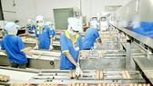 Egg packaging line at Ba Huan Joint Stock Company. (Photo: SGGP)