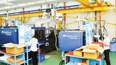 Production of high-tech plastic products at Saigon Industry Corporation. (Photo: SGGP)