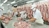 Meat processing at Vissan Company. (Photo: SGGP)