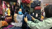 Customers go shopping at Binh Tay Market. (Photo: SGGP)