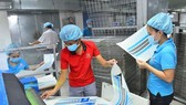 Production at Minh Man Printing Company is still stable despite the Covid-19 pandemic. (Photo: SGGP)