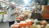 Districts reopen traditional markets cautiously