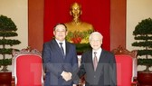 General Secretary of the Communist Party of Vietnam (CPV) Nguyen Phu Trong ​(R) and Lao Deputy Prime Minister Sonexay Siphandone (Source: VNA)