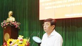 Chairman of the municipal People's Committee Nguyen Thanh Phong speaks in the meeting. (Photo: TTXVN)
