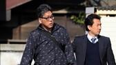 Yasumasa Shibuya (L) was arrested on April 14, 2017, on suspicion of dumping the body of Le Thi Nhat Linh, a third-grader living in Matsudo town (Source: Asahi Shimbun/VNA)