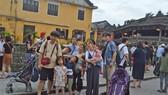 Tourists visit Hoi An ancient town.