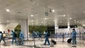 Passengers arrive at Noi Bai Airport.