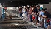 Tourists visit a complex of prisons in Con Dao island.