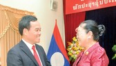 Standing Vice Secretary of the municipal Party Committee Tran Luu Quang (L) and Lao Consul General Phimpha Keomixay