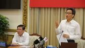 Deputy Prime Minister Vu Duc Dam speaks at the meeting. (Photo: SGGP)