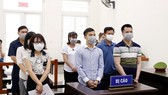 The defendants at the trial (Photo: VNA)