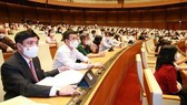 With 95.99 percent of yes votes, the 15th National Assembly on July 28 adopted a resolution on the organisational structure and number of members of the Government (Photo: VNA)