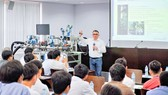 A foreign teacher is teaching at Ton Duc Thang University.