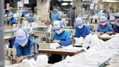 Pandemic-hit businesses are expected to continue benefit from more support measures (Photo: VNA)