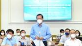 Chairman of the HCMC People's Committee Phan Van Mai speaks at the meeting. (Photo: SGGP)